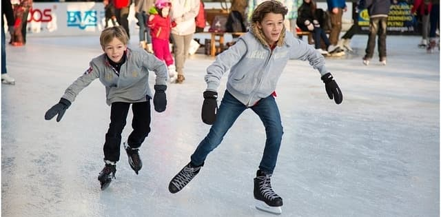 two boys skating on ice