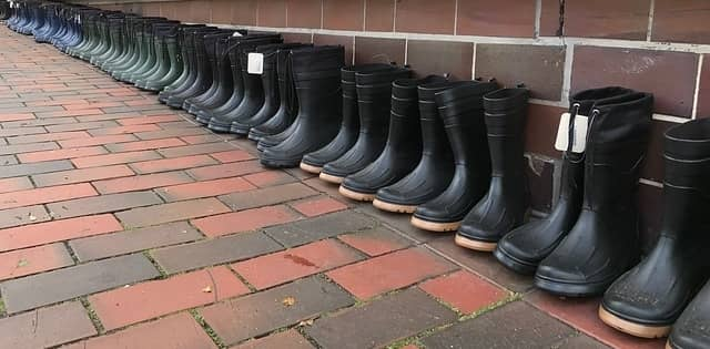 rubber boots against a wall