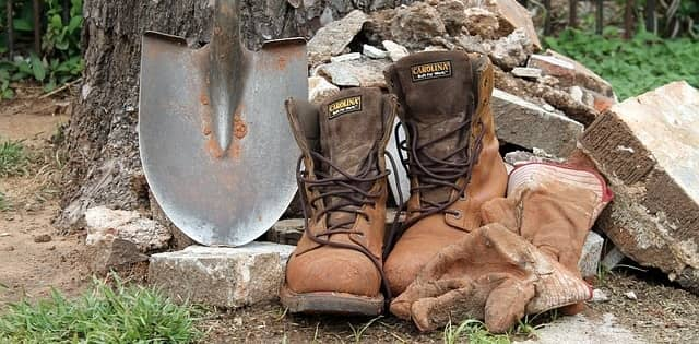 brown work boots with a shovel