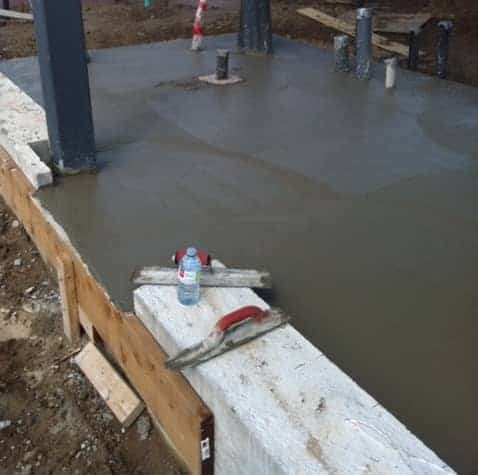 Poured concrete slab being finished