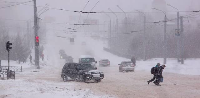 a winter storm in a city street