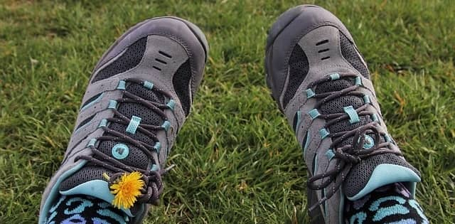pair of hiking shoes outside on grass