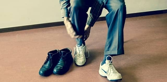 Man changing his shoes