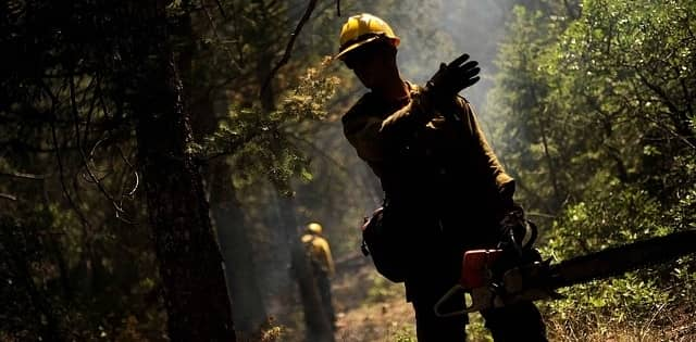 Wildland Fire Fighter with chain saw
